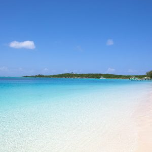A secluded white sand beach in the Caribbean called Tropic of Cancer Beach. The beach features crystal clear calm and shallow water under indigo skies. The pictures was taken on the southern part of Exuma Island, where Pirates of the Caribbean was filmed.