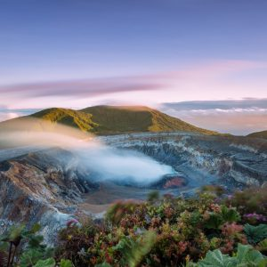 High angle view of crater emitting smoke at sunset, Poas volcano, Costa Rica